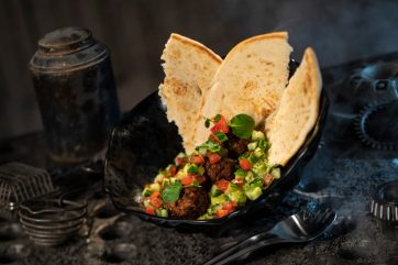 Innovative and creative eats from around the galaxy will be available at Star Wars: GalaxyÕs Edge when it opens May 31, 2019, at Disneyland Park in Anaheim, Calif., and Aug. 29, 2019, at Disney's Hollywood Studios in Lake Buena Vista, Fla. The Felucian Garden Spread, found at Docking Bay 7 Food and Cargo inside Star Wars: GalaxyÕs Edge, is a plant-based kefta ÒmeatballÓ dish with herb hummus and tomato-cucumber relish with pita bread. (David Roark/Disney Parks)
