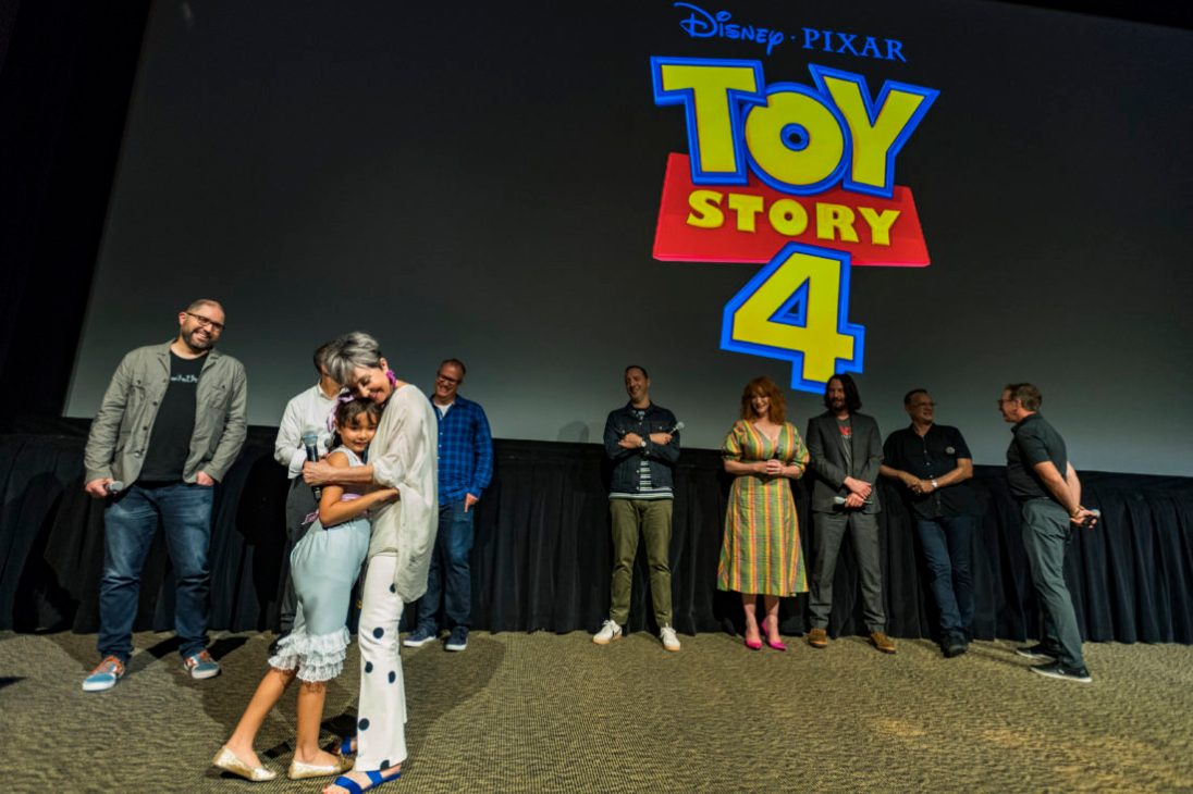 ORLANDO, FLORIDA - JUNE 08: (L-R) Josh Cooley, Jonas Rivera, Annie Potts, Mark Nielsen, Tony Hale, Christina Hendricks, Keanu Reeves, Tom Hanks and Tim Allen surprise fans at an early screening of Pixar's TOY STORY 4 at Disney's Hollywood Studios on June 08, 2019 in Orlando, Florida.