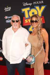 HOLLYWOOD, CA - JUNE 11: John Ratzenberger (L) and Julie Blichfeldt attend the world premiere of Disney and Pixar's TOY STORY 4 at the El Capitan Theatre in Hollywood, CA on Tuesday, June 11, 2019. (Photo by Jesse Grant/Getty Images for Disney) *** Local Caption *** John Ratzenberger; Julie Blichfeldt
