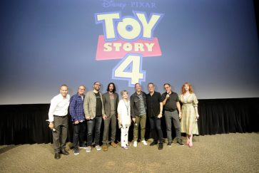 ORLANDO, FLORIDA - JUNE 08: (L-R) Jonas Rivera, Mark Nielsen, Josh Cooley, Keanu Reeves, Annie Potts, Tony Hale, Tom Hanks, Tim Allen and Christina Hendricks surprise fans at an early screening of Pixar's TOY STORY 4 at Disney's Hollywood Studios on June 08, 2019 in Orlando, Florida. (Photo by John Parra/Getty Images for Disney)