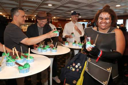 Joe Russo, Christopher Markus, Anthony Mackie and Stephen McFeely are seen with a fan in cosplay the #IMDboat at San Diego Comic-Con 2019: Day Three at the IMDb Yacht on July 20, 2019 in San Diego, California. (Photo by Rich Polk/Getty Images for IMDb)