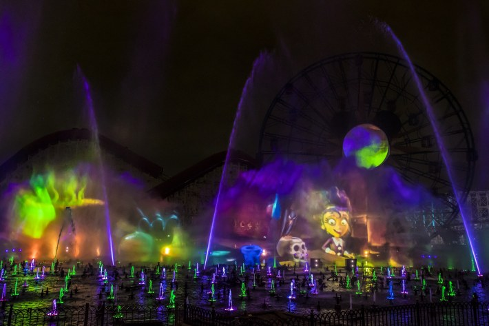 """""""Villainous!"""" is a new """"World of Color"""" show, exclusive to the new separate ticket event, Oogie Boogie Bash – A Disney Halloween Party at Disney California Adventure Park, beginning Sept. 17, 2019, for 20 select nights. The show weaves a Halloween tale about a young girl named Shelley Marie who goes on an unforgettable journey exploring the villainous side of Disney characters. """"Villainous!"""" shows guests that, deep down, there's a little villain in all of us. Disneyland Resort is located in Anaheim, Calif. (Joshua Sudock/Disneyland Resort)"""