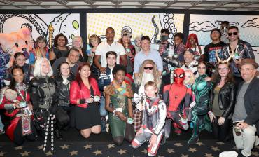 SAN DIEGO, CALIFORNIA - JULY 20: Joe Russo, Anthony Mackie, Anthony Russo, Stephen McFeely and Christopher Markus are seen with fans in cosplay at the #IMDboat at San Diego Comic-Con 2019: Day Three at the IMDb Yacht on July 20, 2019 in San Diego, California. (Photo by Rich Polk/Getty Images for IMDb)