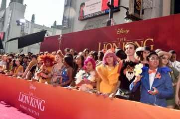 """HOLLYWOOD, CALIFORNIA - JULY 09: Fans attend the World Premiere of Disney's """"THE LION KING"""" at the Dolby Theatre on July 09, 2019 in Hollywood, California. (Photo by Alberto E. Rodriguez/Getty Images for Disney)"""