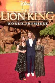 """HOLLYWOOD, CALIFORNIA - JULY 09: James Chinlund (C) and Clare Crespo Chinlund (R) attend the World Premiere of Disney's """"THE LION KING"""" at the Dolby Theatre on July 09, 2019 in Hollywood, California. (Photo by Alberto E. Rodriguez/Getty Images for Disney)"""