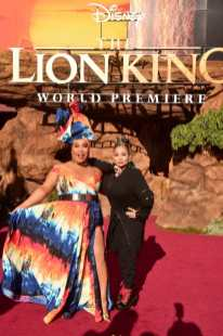 """HOLLYWOOD, CALIFORNIA - JULY 09: Patrick Starrr (L) and Raven-Symone attend the World Premiere of Disney's """"THE LION KING"""" at the Dolby Theatre on July 09, 2019 in Hollywood, California. (Photo by Alberto E. Rodriguez/Getty Images for Disney)"""