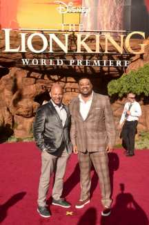 """HOLLYWOOD, CALIFORNIA - JULY 09: Cedric Yarbrough (R) attends the World Premiere of Disney's """"THE LION KING"""" at the Dolby Theatre on July 09, 2019 in Hollywood, California. (Photo by Alberto E. Rodriguez/Getty Images for Disney)"""