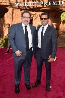 """HOLLYWOOD, CALIFORNIA - JULY 09: Director/Producer Jon Favreau and President, Marketing, The Walt Disney Studios Asad Ayaz attend the World Premiere of Disney's """"THE LION KING"""" at the Dolby Theatre on July 09, 2019 in Hollywood, California. (Photo by Alberto E. Rodriguez/Getty Images for Disney)"""