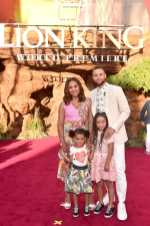 """HOLLYWOOD, CALIFORNIA - JULY 09: (L-R) Ryan Curry, Ayesha Curry, Riley Curry, and Stephen Curry attend the World Premiere of Disney's """"THE LION KING"""" at the Dolby Theatre on July 09, 2019 in Hollywood, California. (Photo by Alberto E. Rodriguez/Getty Images for Disney)"""