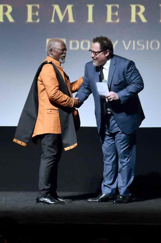 """HOLLYWOOD, CALIFORNIA - JULY 09: John Kani and Director/producer Jon Favreau attend the World Premiere of Disney's """"THE LION KING"""" at the Dolby Theatre on July 09, 2019 in Hollywood, California. (Photo by Alberto E. Rodriguez/Getty Images for Disney)"""