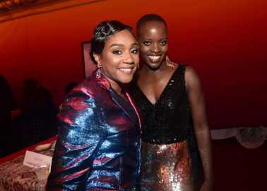 """HOLLYWOOD, CALIFORNIA - JULY 09: Tiffany Haddish (L) and Florence Kasumba attend the World Premiere of Disney's """"THE LION KING"""" at the Dolby Theatre on July 09, 2019 in Hollywood, California. (Photo by Alberto E. Rodriguez/Getty Images for Disney)"""