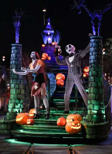 """The guest-favorite """"Frightfully Fun Parade"""" delights guests at Disney California Adventure Park during the all-new separate-ticket Oogie Boogie Bash – A Disney Halloween Party on 20 select nights from Sept. 17-Oct. 31, 2019. The Headless Horseman of Sleepy Hollow heralds the arrival of Mickey Mouse and Minnie Mouse who lead the cavalcade of characters, including many mischievous Disney villains. New this year, the ever-curious and whimsical Cheshire Cat from """"Alice in Wonderland"""" joins the parade, mischievously smiling at all the magical mayhem. (Scott Brinegar/Disneyland Resort)"""