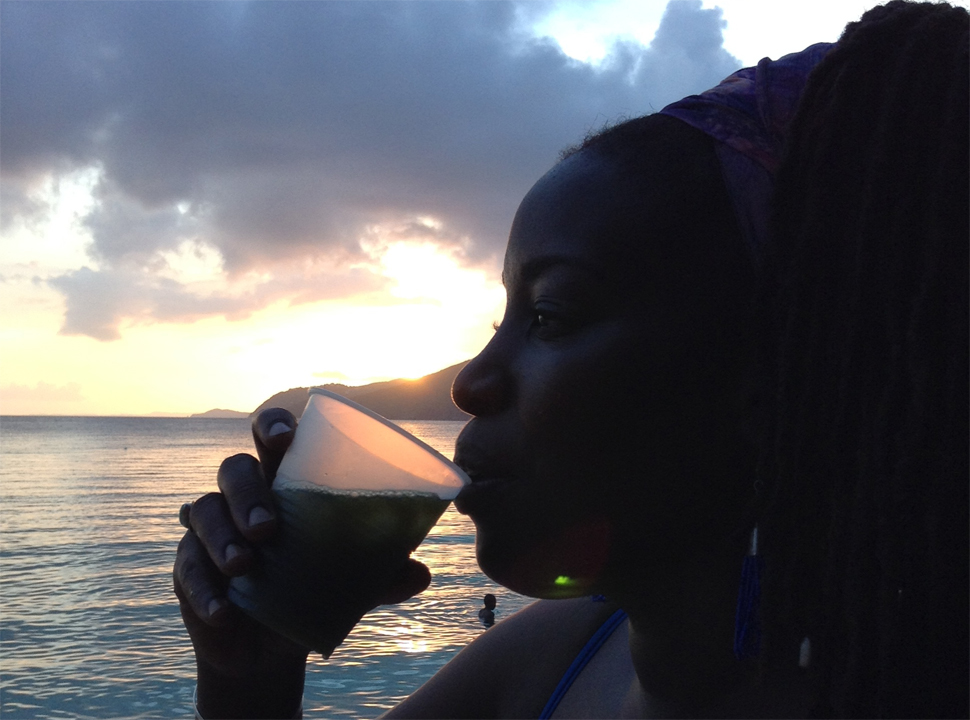 "Jahweh David drinks chlorophyll at sunset, ""because of its healing properties,"" on John Brewers Beach."