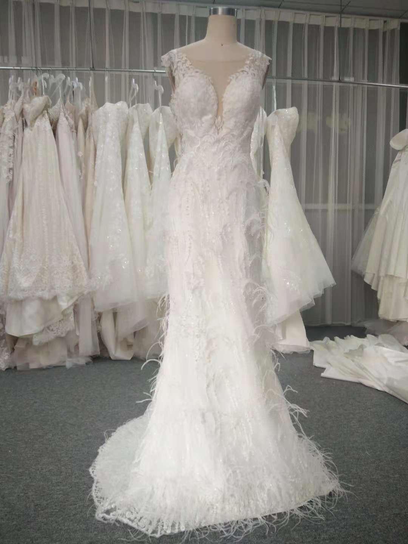 Cap sleeve illusion neckline feather wedding
