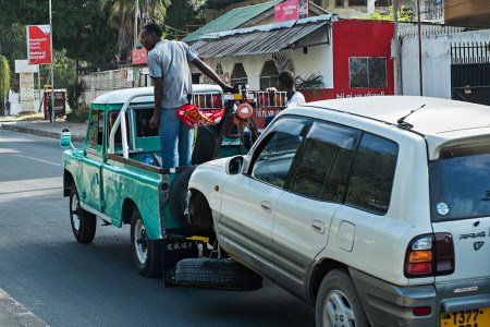 A breakdown service removes a damaged vehicle from the accident scene on UN Road Tuesday morning.