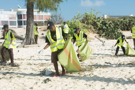 Volunteers clean up Coco Beach on Saturday, September 19. Photo: contributed