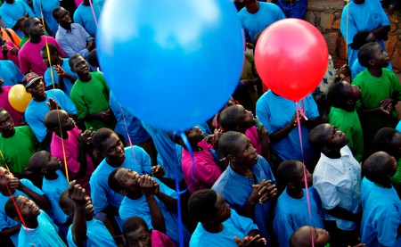 Children sponsored by Canadians, Americans and Germans release helium filled balloons as a symbolic thanks to their sponsors thousands of kilometres away. The children are sponsored through programs run by the Church of God and Kinderhilfswerk. Photo: Daniel Hayduk