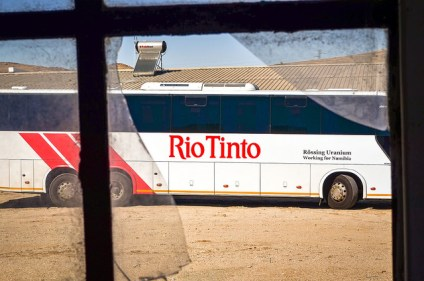 """Rio Tinto bus and broken glass at the Rössing mine, Namibia"" by jbdodane on Flickr."