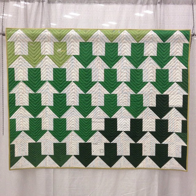 """My Profits & Losses quilt hanging in the show; @quiltersdream wool batting, @carolynfriedlander + Yoshiko Jinzenji, peppered cotton greens, @cottonandsteel gold binding, gold thread. Thanks @theMQG I was really nervous about entering my first show, but I'"" by gina pina on Flickr"