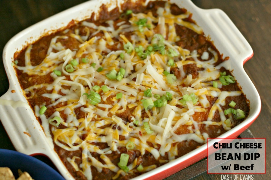 This easy Chili Cheese Bean Dip is always a party favorite--everyone will be asking for the recipe! via @DashOfEvans #Dips #CheeseDip #Beans #Tailgating #Party #Appetizer #SuperBowl