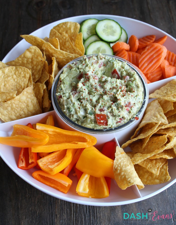 The best guacamole recipe! It's always the first dip gone at any party. Find out a cool new tool to keep it fresh longer and how to pick the perfect avocado! via @DashOfEvans