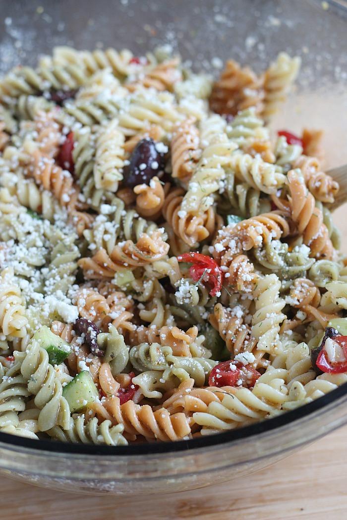 Quick & Easy Homemade Pasta Salad...a summer staple! via @DashOfEvans