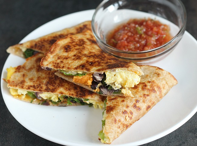 Delicious breakfast quesadilla with egg, peppers, black beans, sweet potato and cheese, toasted in a crispy wheat tortilla. YUM! via @DashofEvans for @ProduceforKids