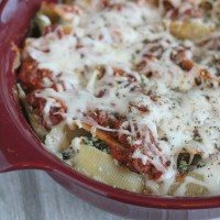 These beef and vegetable stuffed lasagna shells are perfect for your next Sunday dinner or when you're craving comfort food. This recipe will be your next go-to for an easy pasta night! via @DashOfEvans