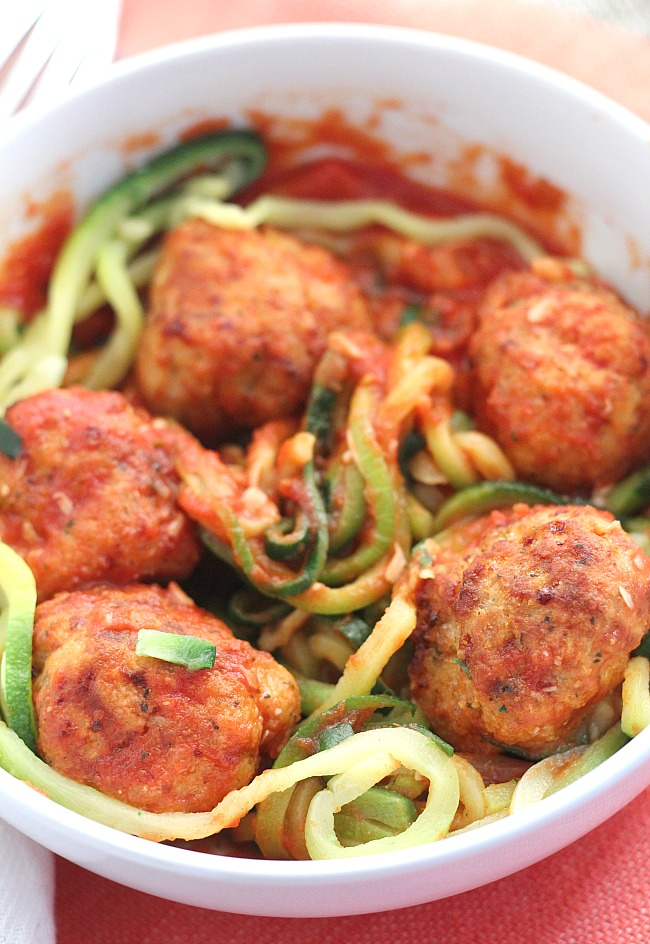 Delicious (and healthy!) air fryer turkey meatballs are paired with Green Giant zucchini noodles for a filling and hearty dinner. Use a store bought marinara or my simple sauce with torn basil. YUM! via @DashOfEvans #VeggieSwapIns #IC