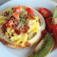 Who says you can't have pizza for breakfast? These Bay's English Muffin breakfast pizzas are perfect for the whole family. Topped with salsa, scrambled eggs, peppers and bacon, sausage or ham. YUM! For brunch, make a fun breakfast pizza station for everyone to make their own. via @DashOfEvans #BaysEnglishMuffins