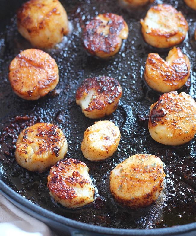 If you have kids, date nights are hard to come by. Try doing fun date night IN meals after the kiddos go to bed. It saves money and it's a great way to try a new recipe and some wine together. This Smoky Scallops recipe is easy, but seems super fancy! via @DashOfEvans