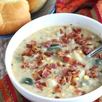 Creamy corn chowder is the perfect end of summer soup recipe--use up all of that garden produce...or an excuse to head to the farmer's market! Fresh corn, zucchini, red potatoes and peppers are paired in this creamy chowder with bacon! YUM! via @DashOfEvans