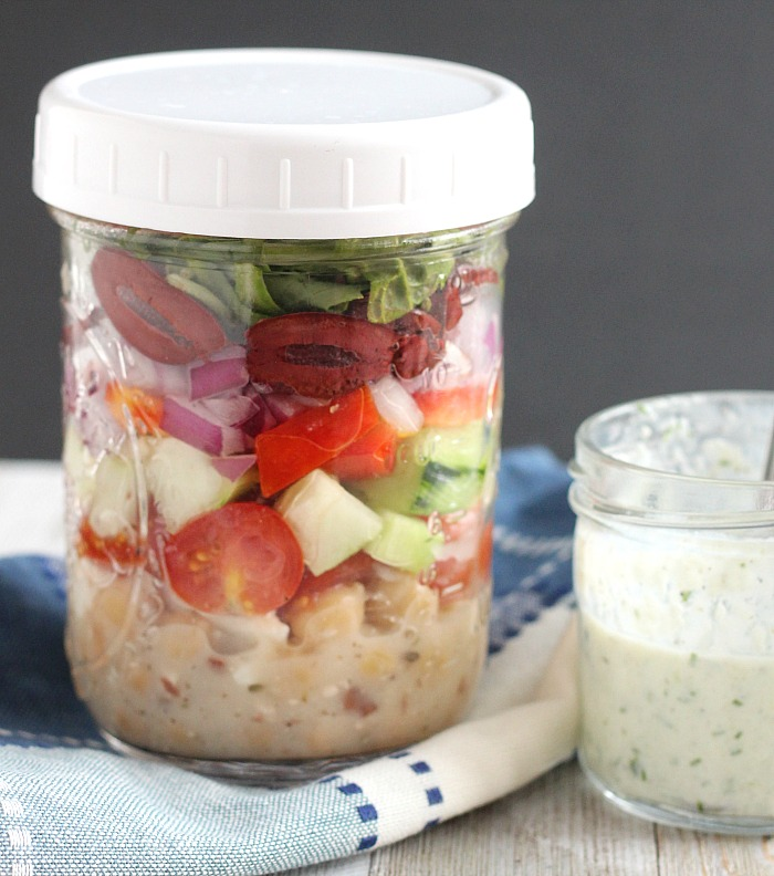 This easy Vegetarian Greek Salad with Chickpeas is perfect for lunches! A perfect mason jar salad! Be sure to shop for Jump for Jill sponsored products at Meijer! via @DashOfEvans