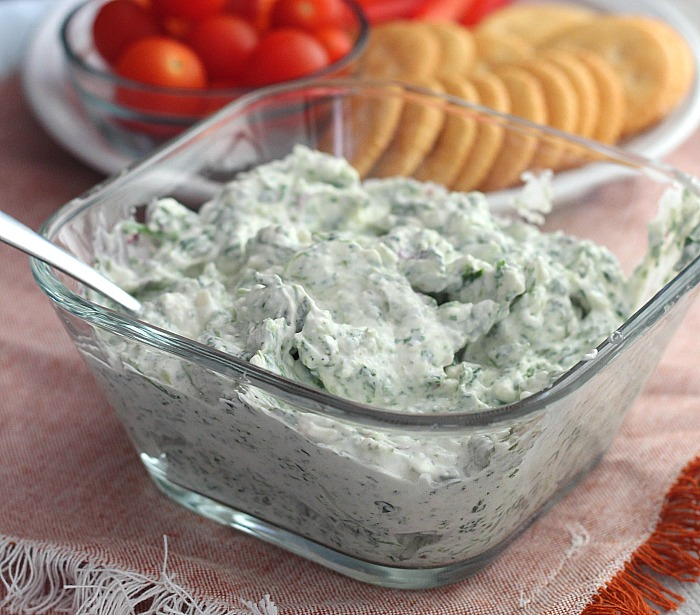Easy, creamy whipped feta dip with spinach, green onions and lemon juice. Super quick and easy to make for a party! Dip baby, dip! YUM! @DashOfEvans