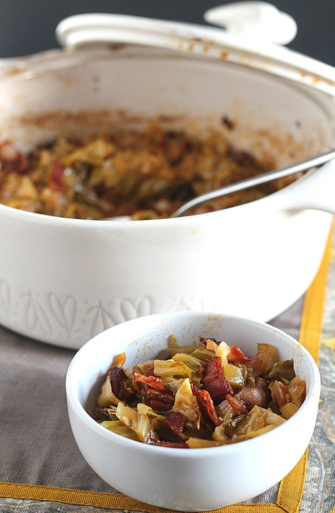 Looking for a low carb side dish for Thanksgiving or holiday cooking? Try this Braised Cabbage with bacon and Michigan Honeycrisp apples! You won't miss the carbs after trying this Keto and Whole 30 friendly dish. via @DashOfEvans