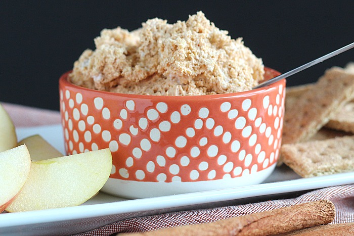 Pumpkin fluff dip is a fall favorite of ours! In less than 5 minutes, you have a great after school snack to dunk local apples in! via @DashOfEvans