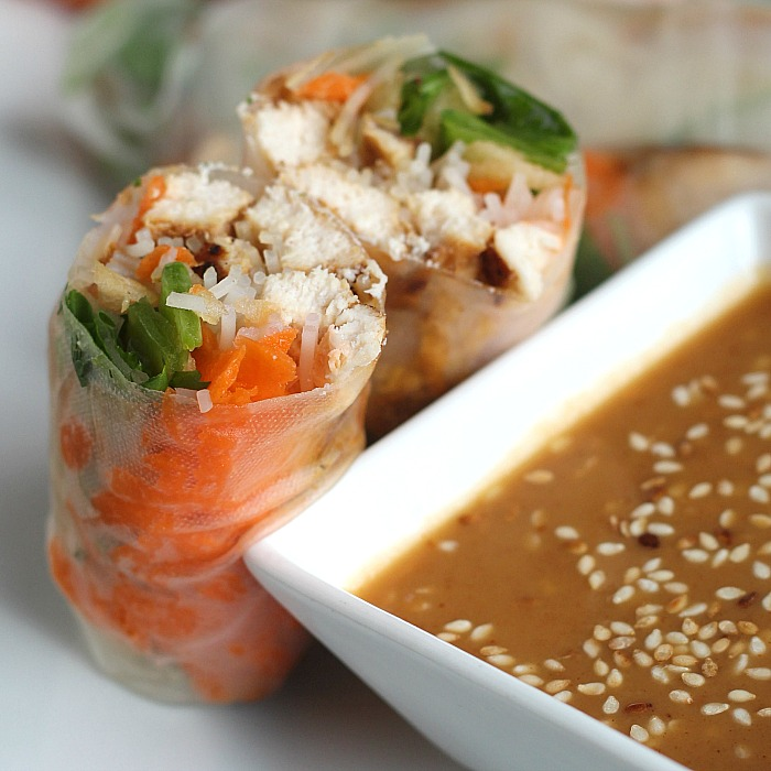 Crunchy, sweet Michigan Apples add a new twist to these delish spring rolls. Add marinaded chicken, your favorite veggies and wrap up. This is great for the whole family to do--after a little practice, spring rolls are SO easy. Don't forget this simple peanut sauce to dunk them in! via @DashOfEvans #MichiganApples