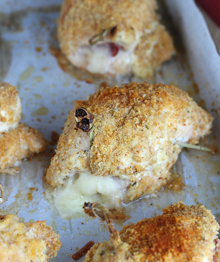 This easy, baked Chicken Cordon Bleu is a twist on the classic recipe. Using zesty ranch and topped with a gooey cheese sauce, this is a recipe the whole family will love! Serve with potatoes, salad or rice on the side. YUM! via @DashOfEvans