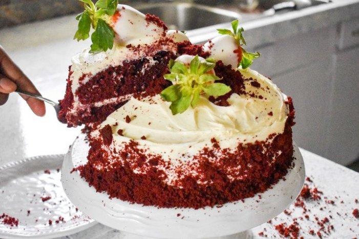 slicing red velvet cake