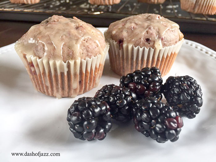 blackberry spice muffins plated with fresh blackberries