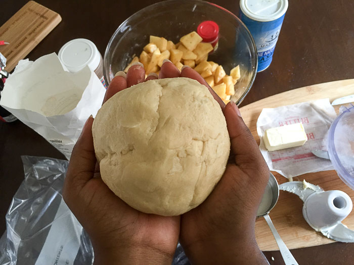 holding ball of pie crust dough