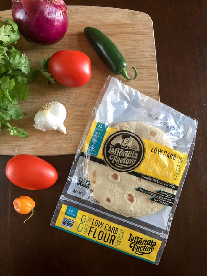 salsa ingredients and tortillas on cutting board