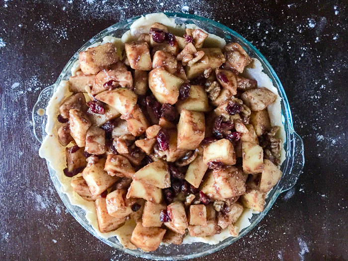 Honeycrisp apples, pears, cranberries, maple syrup, and warm spices between a flaky buttery crust and crisp oat topping = the ultimate autumn apple pie. Recipe by Dash of Jazz