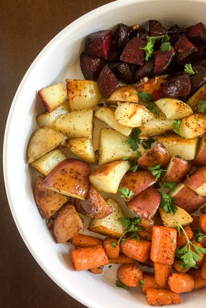 platter of colorful root vegetables garnished with parsley.