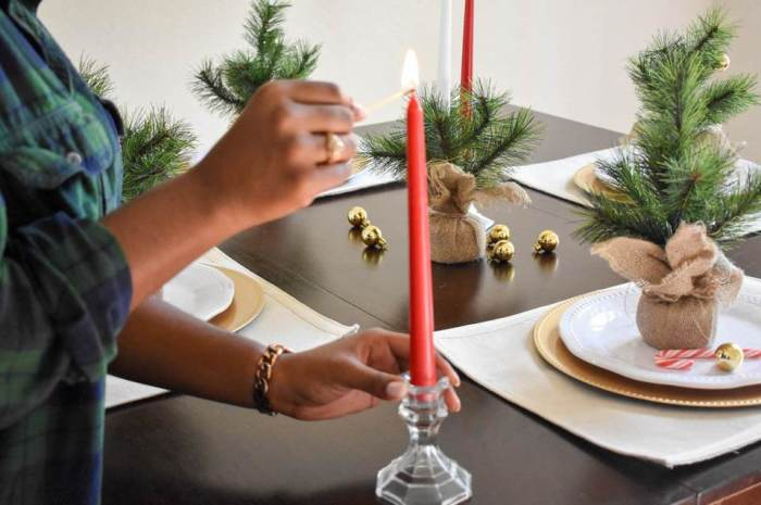 lighting red taper candle