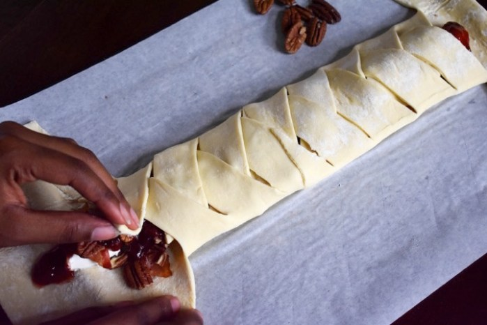 braiding stuffed puff pastry dough