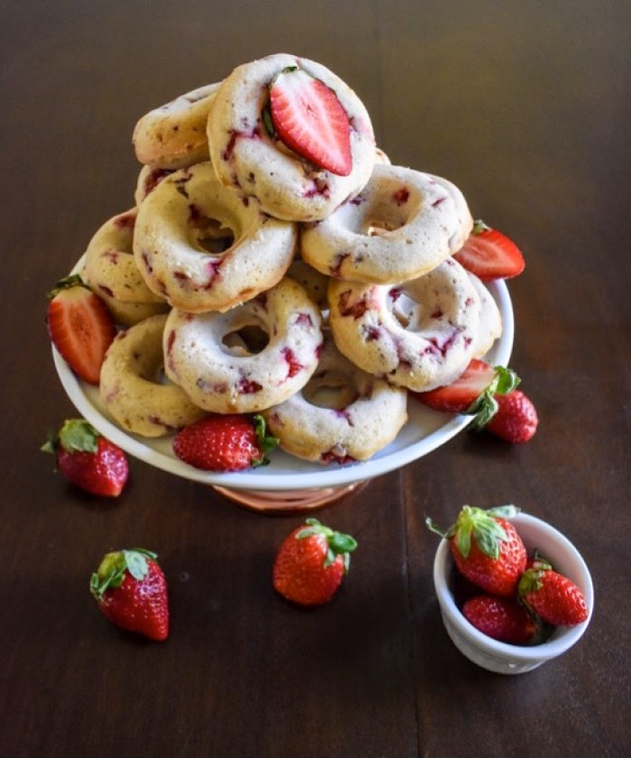 These strawberry cake donuts are delicious, easy to make, and have an addictive, delicate flavor. If you can make cupcakes, you can make these! by Dash of Jazz