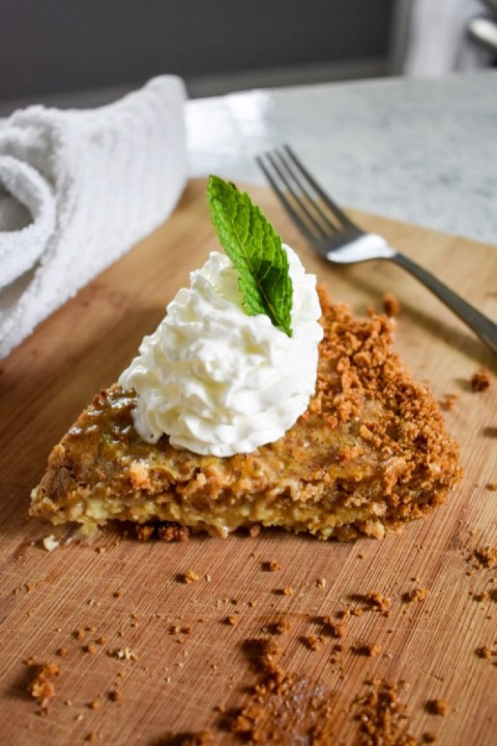 slice of grapefruit & ginger pie garnished with whipped cream and mint