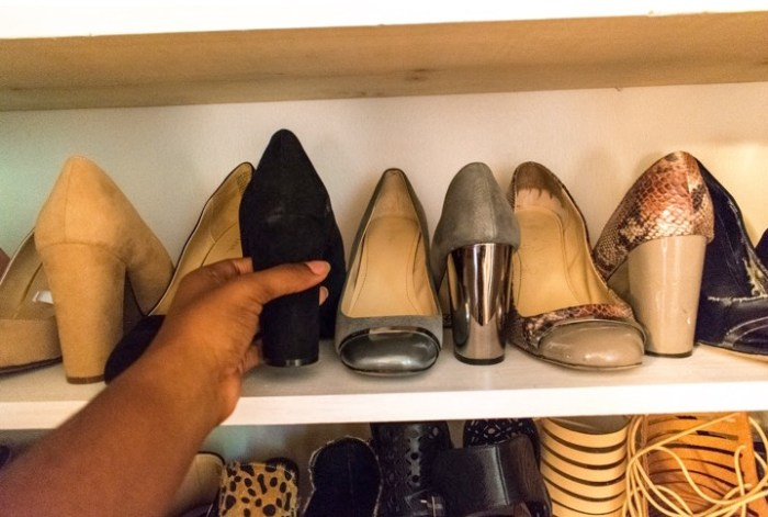 picking shoes out of shoe closet