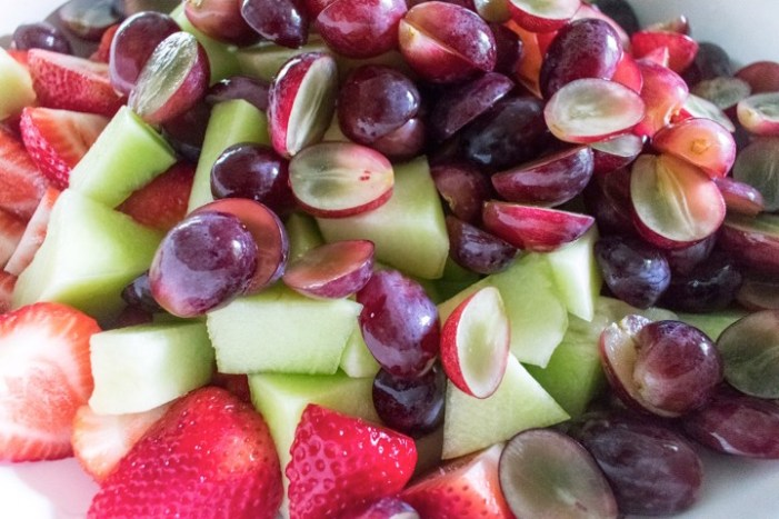 sliced grapes, honeydew melon, and strawberries